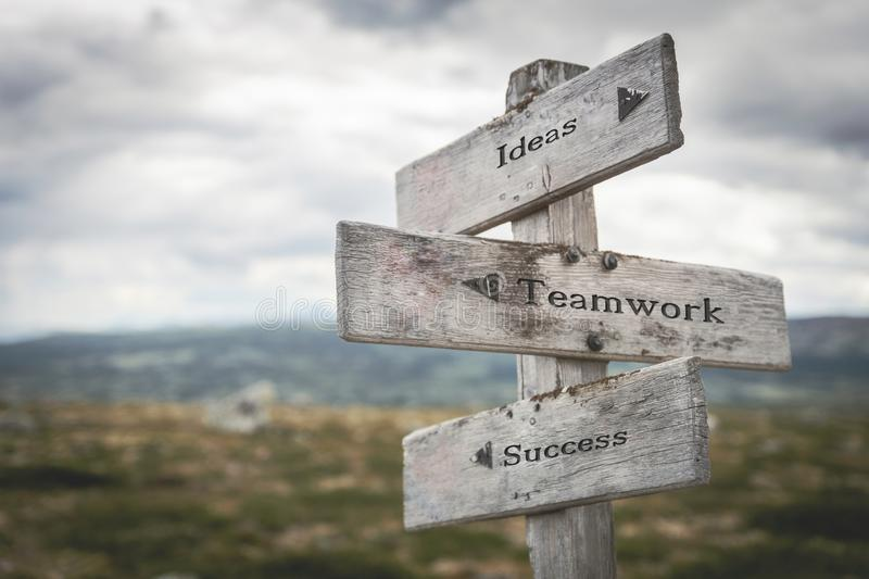 Ideas, teamwork and success signpost outdoors in nature. Road, choose, together, business and corporate concept royalty free stock photography