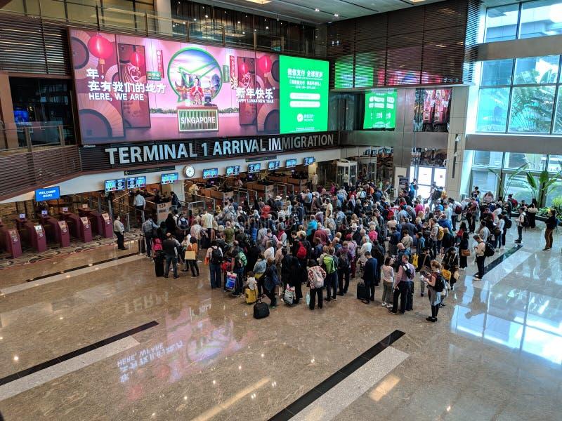 Ideia do controle da imigração no aeroporto internacional de Changi em Singapura foto de stock