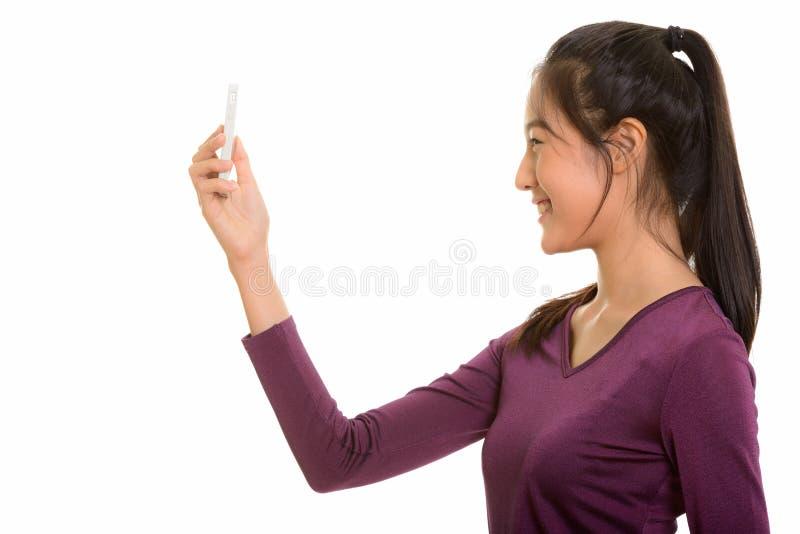 Ideia do perfil do quando de sorriso tak do adolescente asiático feliz novo foto de stock royalty free