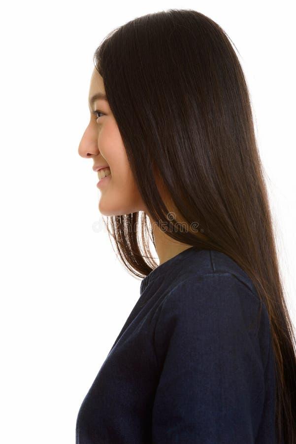 Ideia do perfil do sorriso asiático feliz novo do adolescente fotografia de stock