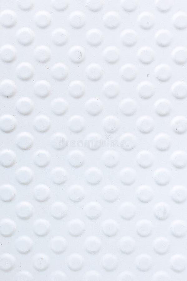 Ideia superior do fundo branco redondo da textura do teste padr?o na banheira abandonada para o anti deslizamento imagens de stock royalty free