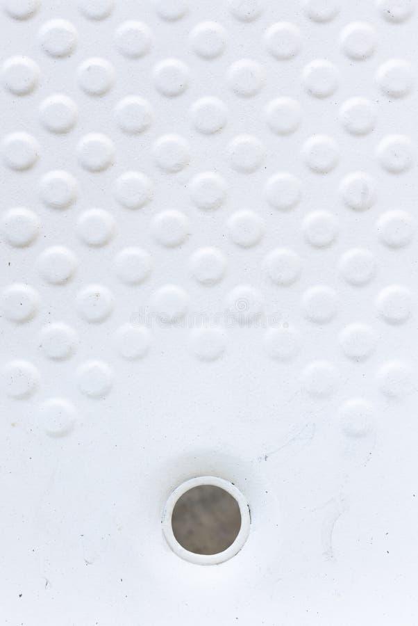 Ideia superior do fundo branco redondo da textura do teste padrão na banheira abandonada para o anti deslizamento sem dreno fotografia de stock