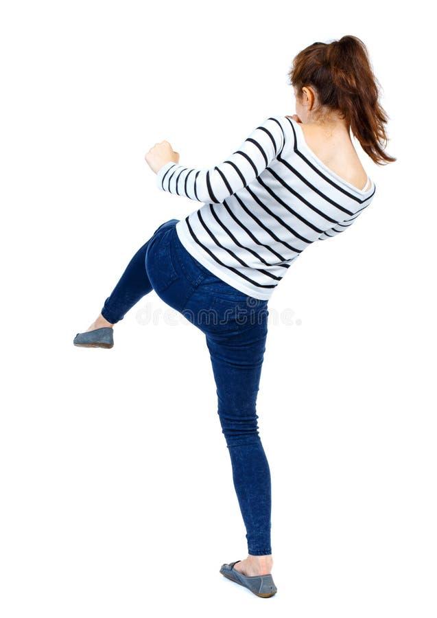 Ideia traseira das lutas engraçadas da mulher que acenam seus braços e pés fotografia de stock royalty free