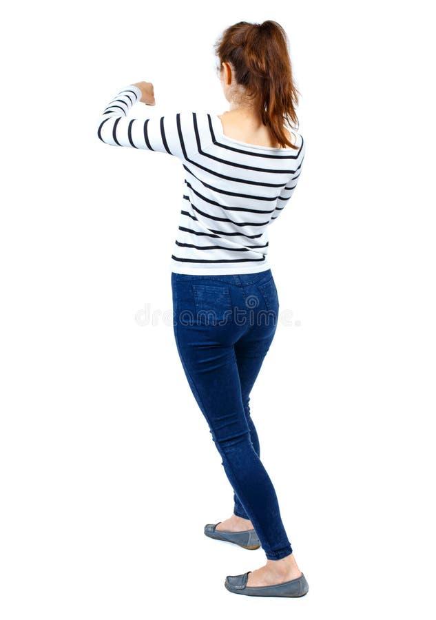 Ideia traseira das lutas engraçadas da mulher que acenam seus braços e pés foto de stock royalty free