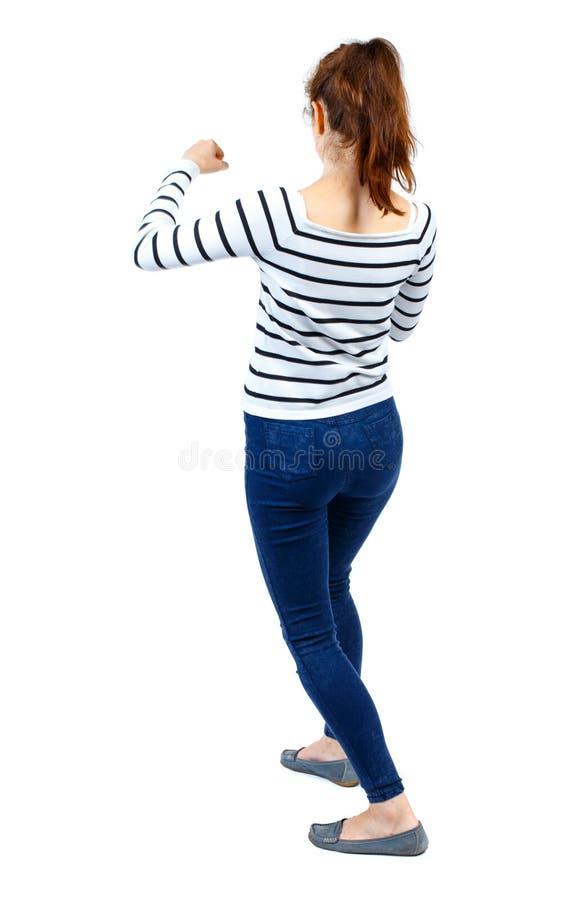 Ideia traseira das lutas engraçadas da mulher que acenam seus braços e pés imagem de stock