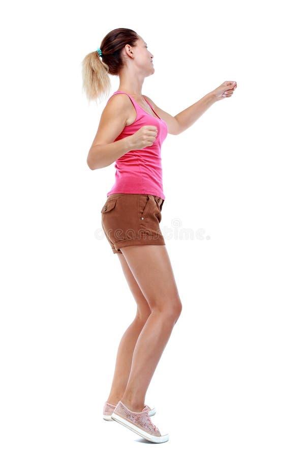 Ideia traseira das lutas engraçadas da mulher que acenam seus braços e pés fotos de stock royalty free
