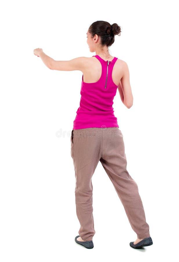 Ideia traseira das lutas engraçadas da mulher que acenam seus braços e pés fotos de stock
