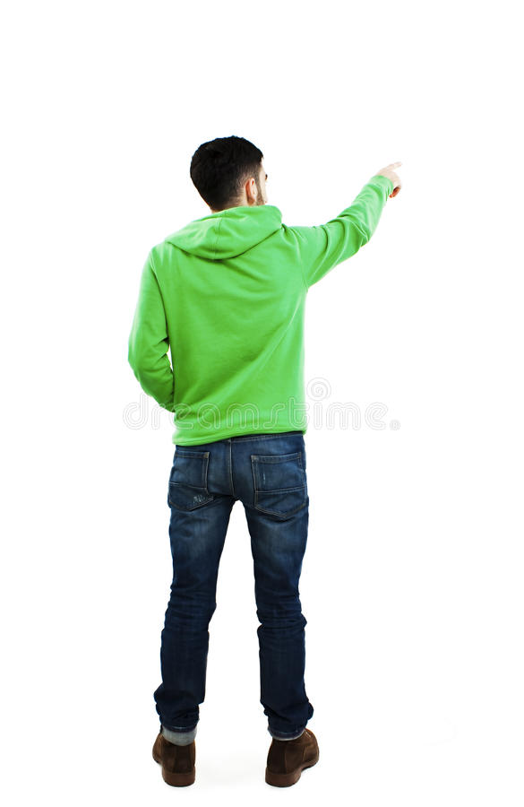 Ideia traseira de apontar homens novos na camiseta e nas calças de brim imagem de stock royalty free