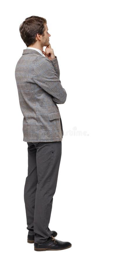Ideia traseira de olhares do homem de negócio foto de stock