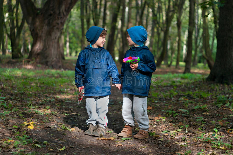 Identical twin brothers with toy guns royalty free stock photos