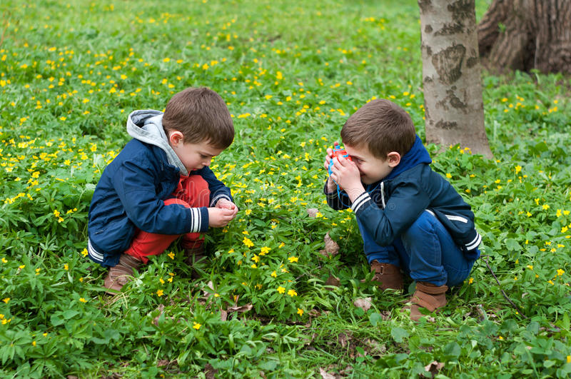 Identical twins playing photographer stock image