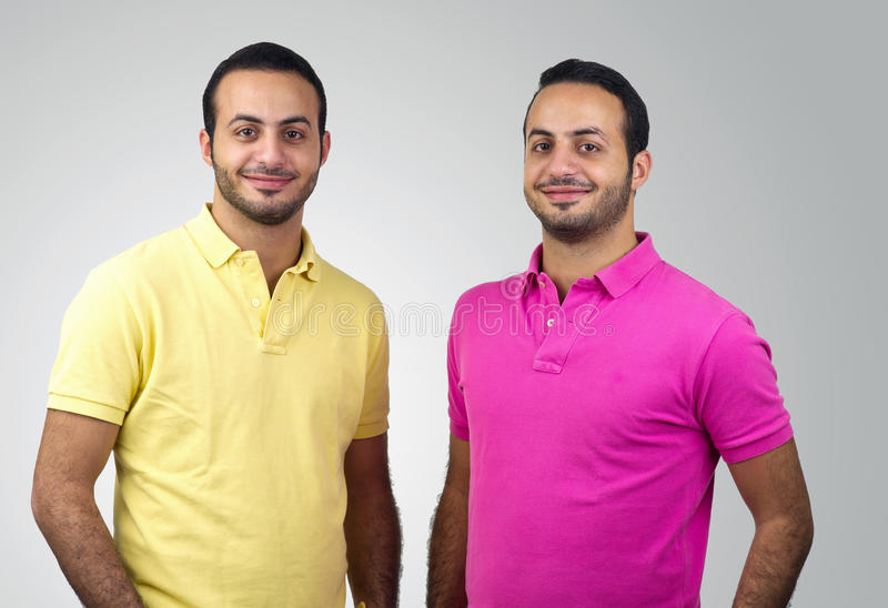 Identical twins portraits shot against white background royalty free stock photo