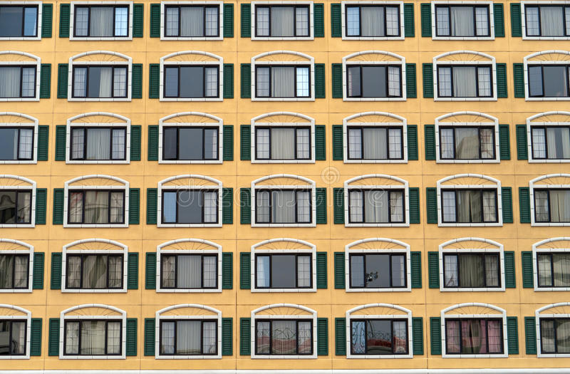 Download Identical Windows In A Large Building Stock Photo - Image of yellow, symmetry: 28314016