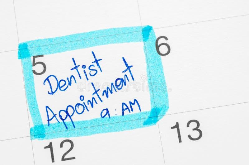 Identificar do calendário por meio de dentista imagens de stock