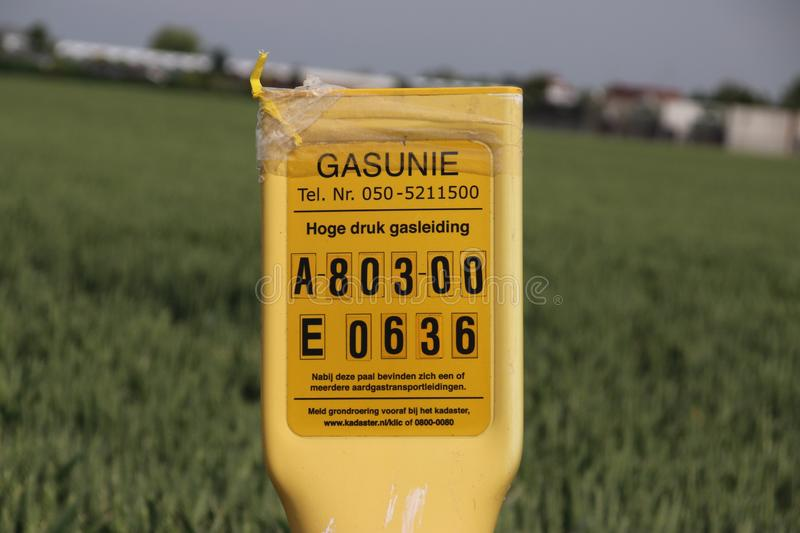 Identification numbers and signs to warn for a high pressure natural gas pipe in the ground. Identification numbers and signs to warn for a high pressure stock images