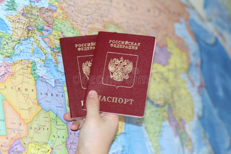 Identitetsdokument på bakgrunden av en geografisk översikt royaltyfri foto