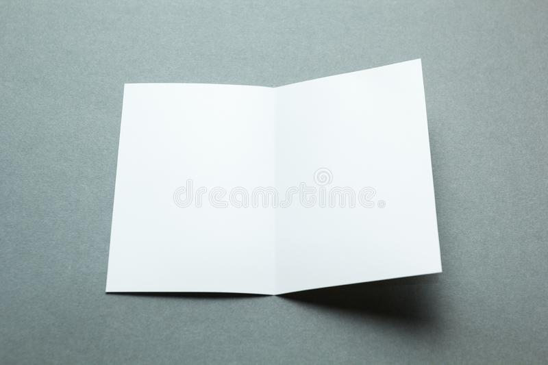 Identity design, corporate templates, company style, blank white folding paper flyer on gray background stock photography