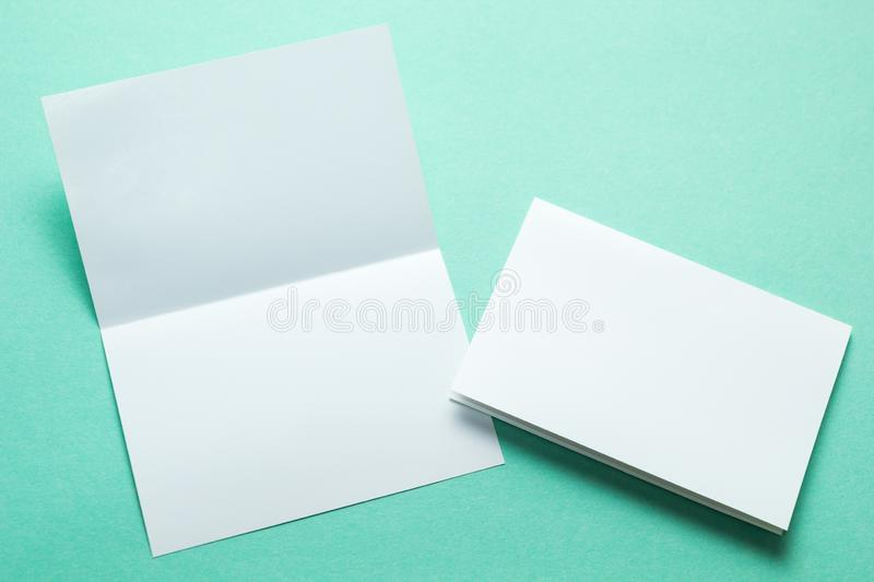 Identity design, corporate templates, company style, blank white folding paper flyer on a green background.  stock photo