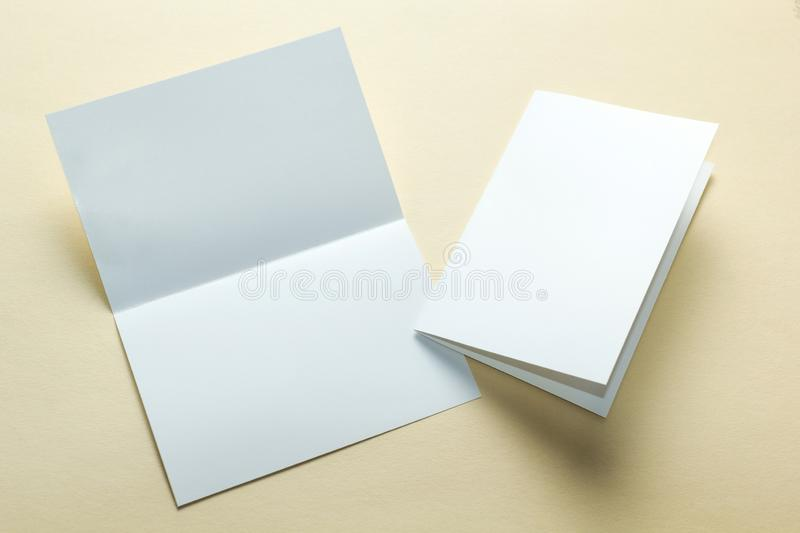 Identity design, corporate templates, company style, blank white folding paper flyer on a yellow background. mockup.  stock image