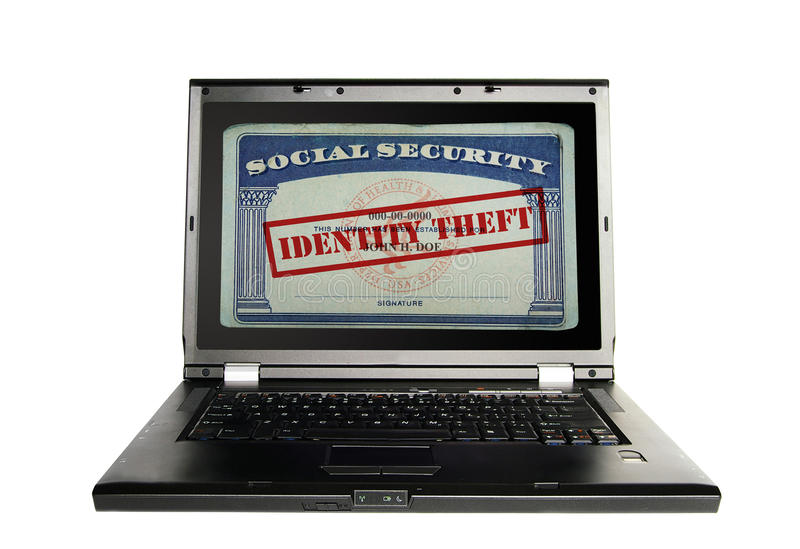 Identity theft concept. Laptop with a Social Security card and Identity Theft text in red royalty free stock photos