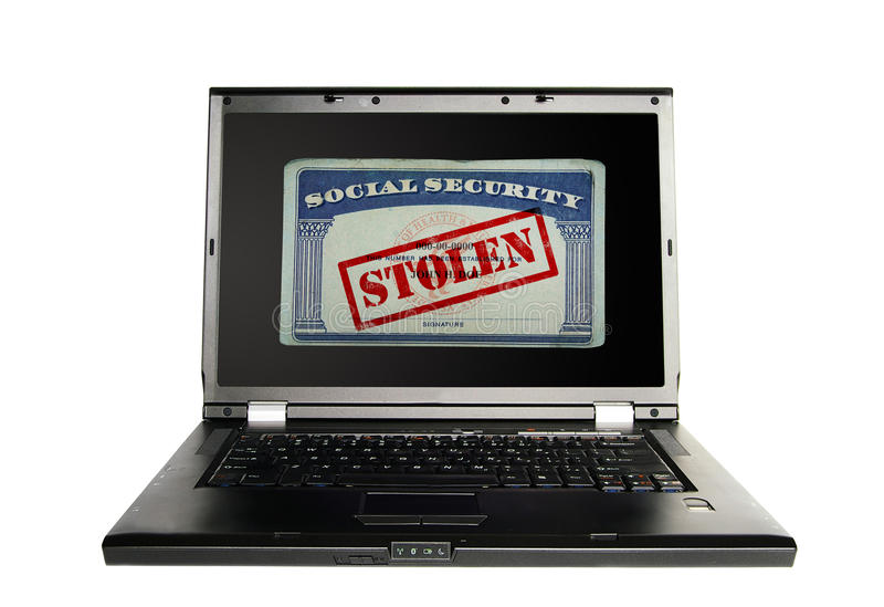 Identity theft. Laptop with a Social Security card and Stolen text in red -- Identity Theft concept stock photography