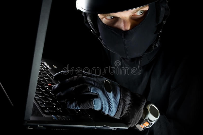 Identity Theft With Man Working On Laptop Stock Image