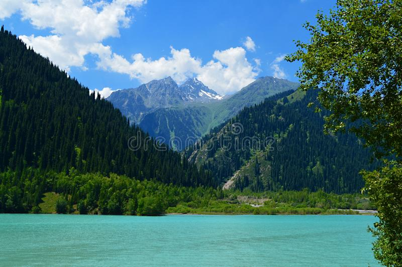 Idillyc july landscape with mountain lake Issyk, National Park, Kazakhstan royalty free stock photography