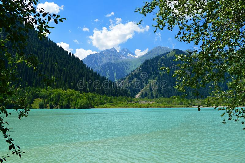 Idillyc july landscape with mountain lake Issyk, National Park, Kazakhstan stock photography
