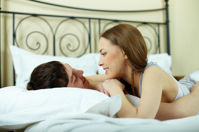 Idling in bed stock image
