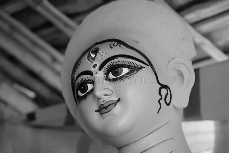 Idol of Hindu Goddess Durga during preparations. In Kolkata stock photography