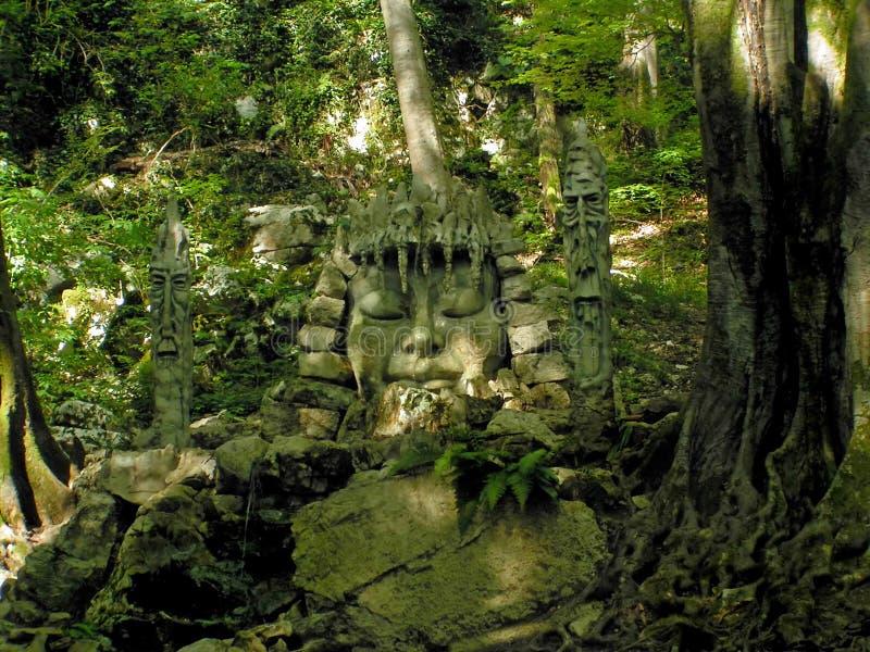 Idol in jungle. Stone idol in green jungle royalty free stock photos
