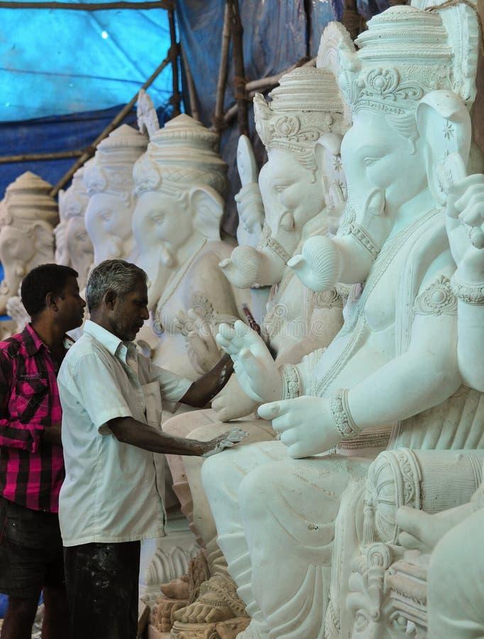 Idol workers in Mumbai. Working on Ganpati idol royalty free stock photos