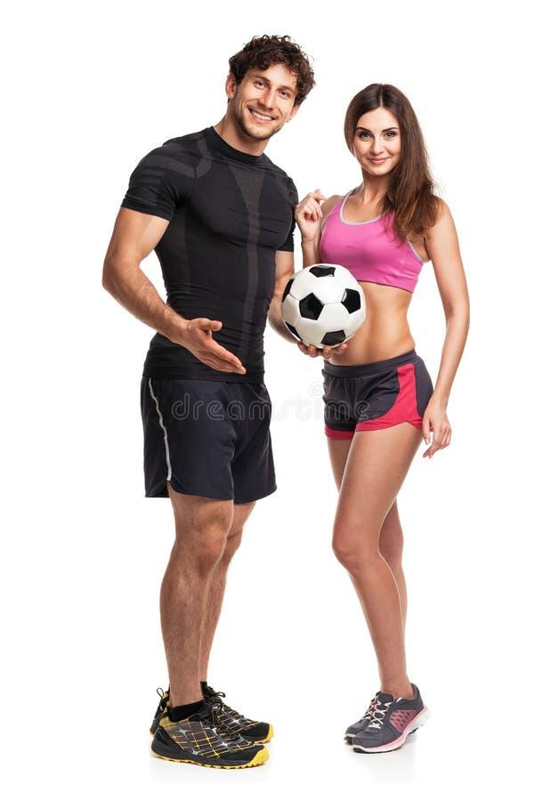 Idrotts- par - man och kvinna med bollen på viten royaltyfria foton