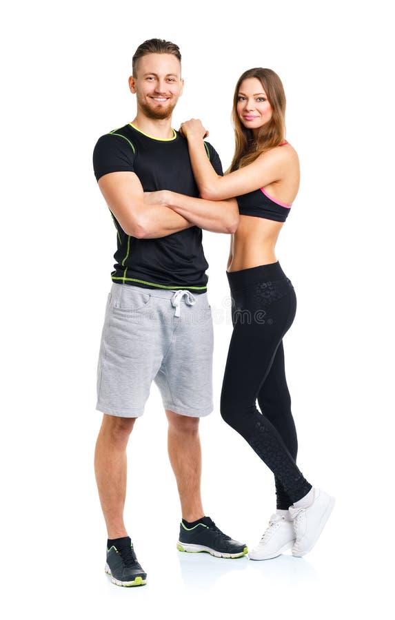 Idrotts- par - mannen och kvinnan efter kondition övar på when arkivfoton