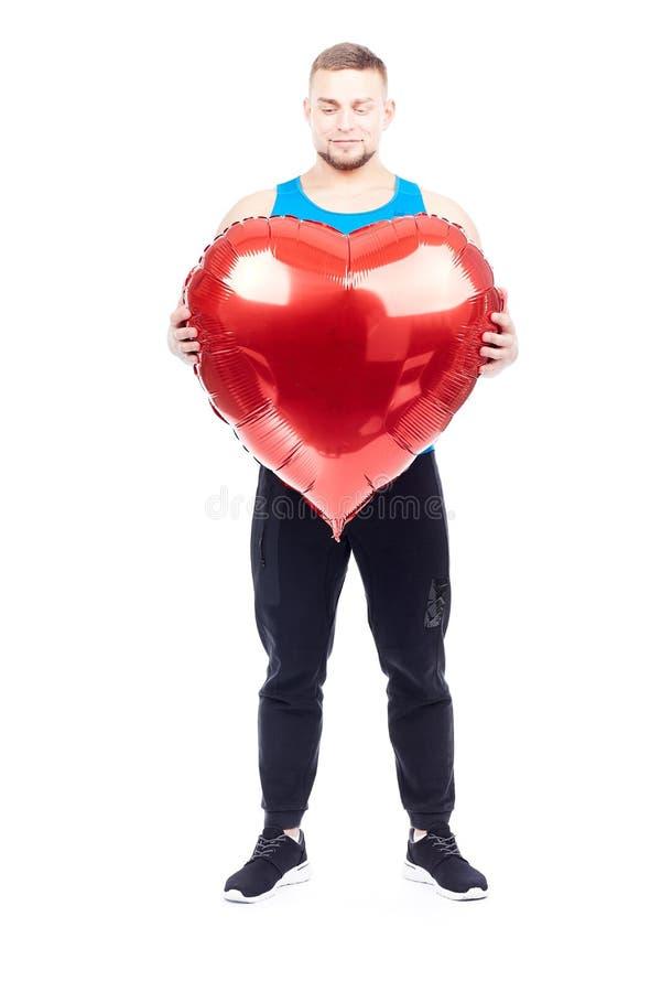 Idrottsman nen med denformade ballongen arkivfoto