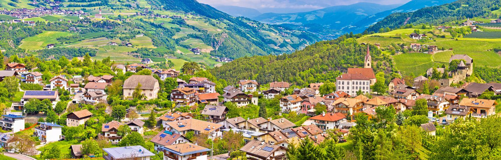 Idyllic alpine village of Gudon architecture and landscape panoramic view royalty free stock images