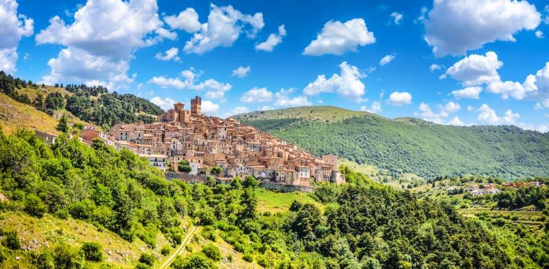 Idyllic apennine mountain village Castel del Monte, L'Aquila, Abruzzo, Italy. Beautiful view of idyllic village Castel del Monte, set into a steep hillside under royalty free stock photos