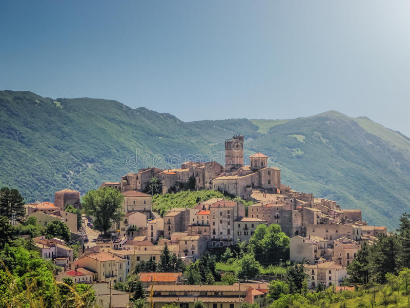 Idyllic apennine mountain village Castel del Monte, L'Aquila, Abruzzo, Italy. Beautiful view of idyllic village Castel del Monte, set into a steep hillside under stock photography
