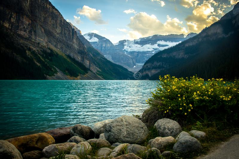Idyllic atmosphere on the way around Lake Louise in Banff, in the Rocky Mountains, Banff National Park, Alberta, Canada. Relax and explore wilderness around royalty free stock photo
