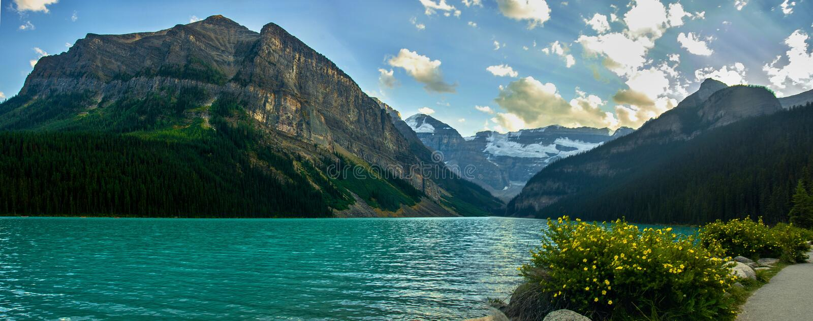 Idyllic atmosphere on the way around Lake Louise in Banff, in the Rocky Mountains, Banff National Park, Alberta, Canada. Relax, explore, do whatever you want stock photo