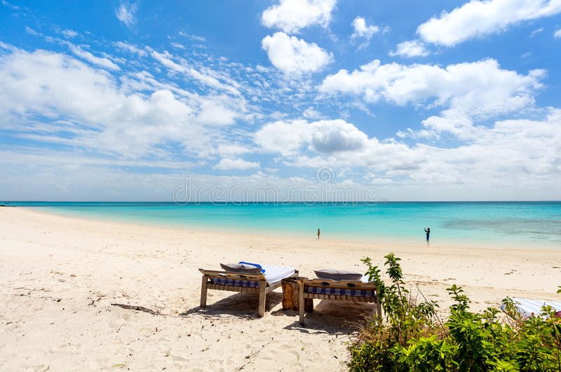 Idyllic beach in Africa. Idyllic tropical beach with white sand, turquoise ocean water and blue sky in Mozambique Africa stock photography