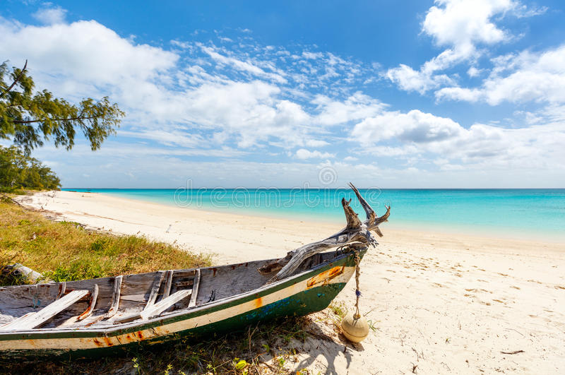 Idyllic beach in Africa. Idyllic tropical beach with white sand, turquoise ocean water and blue sky in Mozambique Africa royalty free stock photos