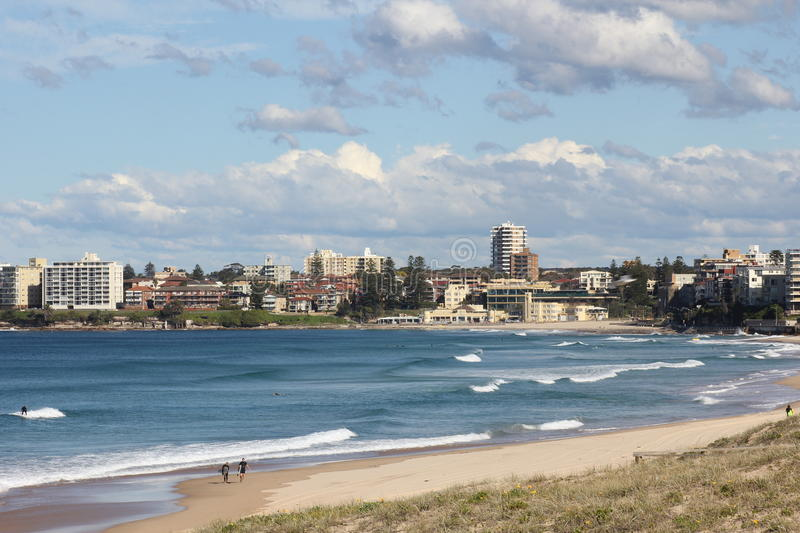 Idyllic Australian beach bay with town stock images