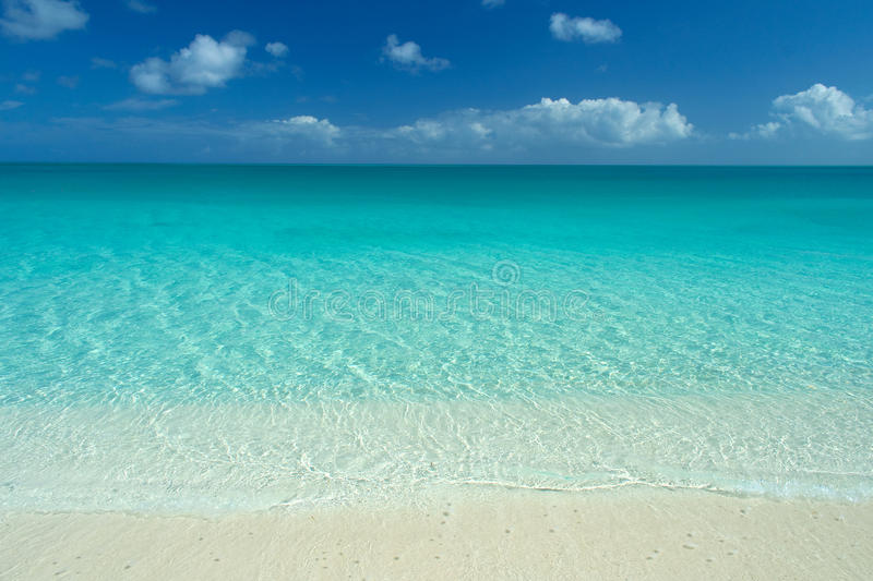 Idyllic caribbean beach. Wide angle view of perfect caribbean white sand beach, turquoise waters and blue sky stock photo