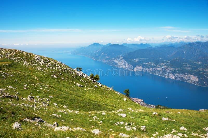 Idyllic hiking area monte baldo, malcesine, with stunning view to garda lake. Blue sky with copy space stock image