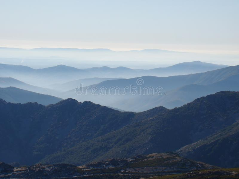 Idyllic landscape with fog. Beautiful landscape with mountains and valleys. Fog is seen in the valleys making a sensation of tranquility royalty free stock photo