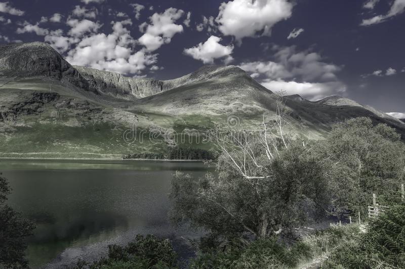 Idyllic landscape of Lake District National Park, Cumbria, UK. UNESCO world heritage side.Beautiful scenery of mountain valley with cristal clear lake in spring royalty free stock photo
