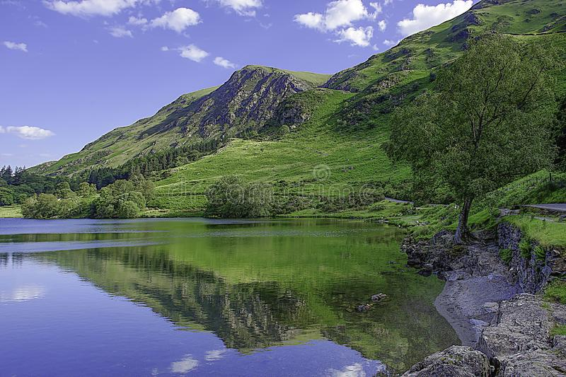 Idyllic landscape of Lake District National Park, Cumbria, UK. UNESCO world heritage side.Beautiful scenery of mountain valley with cristal clear lake in spring royalty free stock image