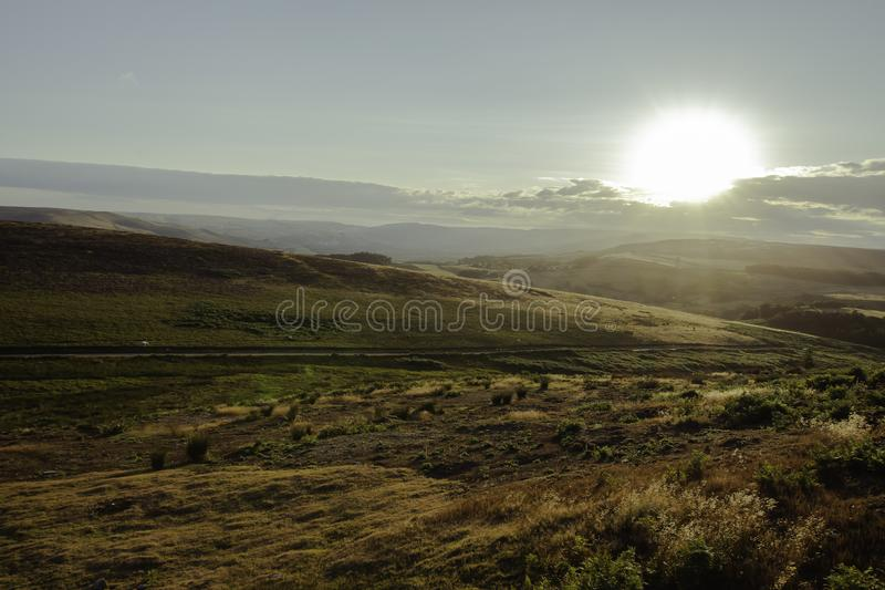 Idyllic landscape of Peak District National Park, Derbyshire, Uk. Sunset over scenic mountain valley on summer evening.Moorland covered with dry grass and stock photo