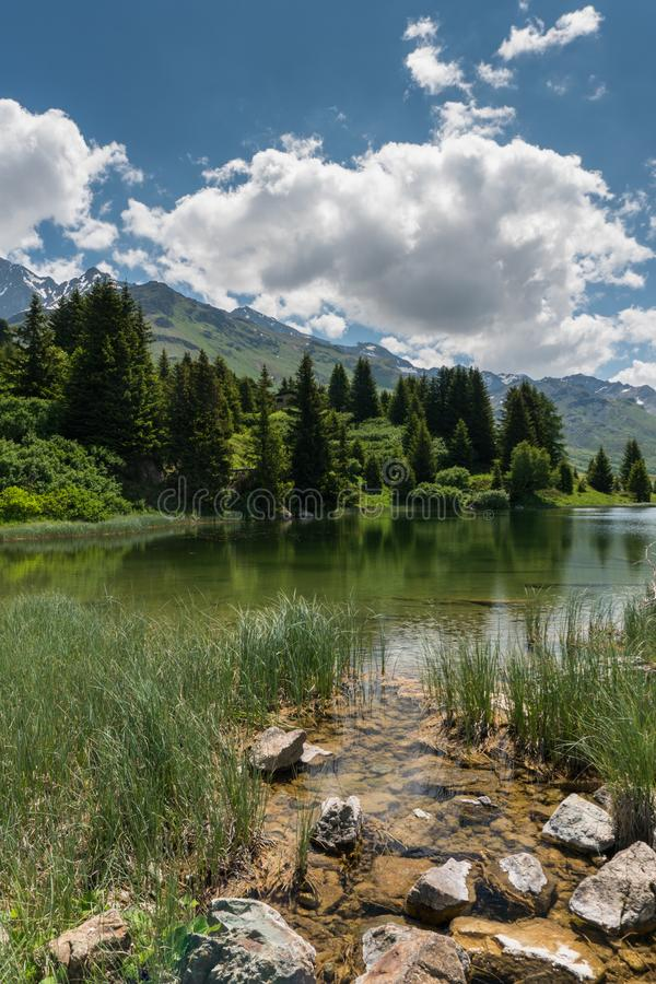 Idyllic mountain lake landscape in the Swiss Alps. An idyllic mountain lake landscape in the Swiss Alps royalty free stock images